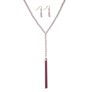 "Pink beaded necklace set with a 3 1/4"" chain tassel. Approximately 32"" in length."