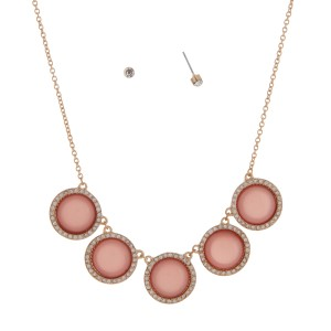 "Gold tone necklace set displaying five shimmering pink disk with a halo. Approximately 18"" in length."