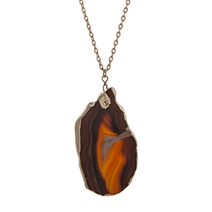 "Gold tone necklace displaying a brown teardrop shape natural stone pendant. Approximately 29"" in length."