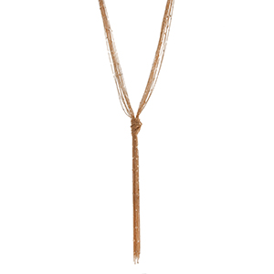 "Gold tone multiple strand necklace displaying delicate chains with a knot. Approximately 42"" in length."