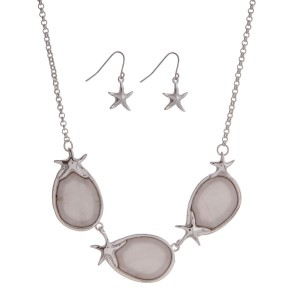 "Silver tone necklace set with Mother of Pearl and starfish accents. Approximately 18"" in length with 3"" extender."