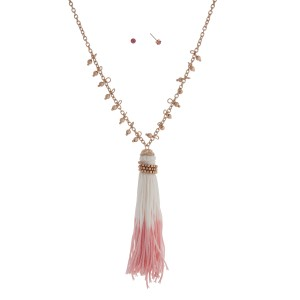 """Worn gold tone necklace with metal beads and a pink and ivory 3 1/2"""" fabric tassel. Approximately 29"""" in length."""