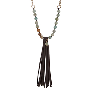 "Burnished gold tone necklace with amazonite stone beads and 5"" brown faux leather tassel. Approximately 24"" in length."