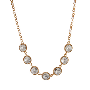 "Matte gold tone necklace displaying round clear rhinestones. Approximately 17"" in length."