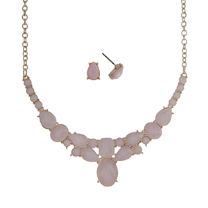 "Gold tone necklace set displaying multiple shape pink cabochons. Approximately 16"" in length."