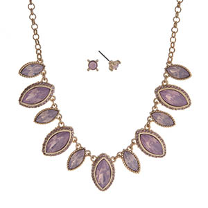 "Gold tone necklace set displaying pink marquee shape cabochons. Approximately 15"" in length."