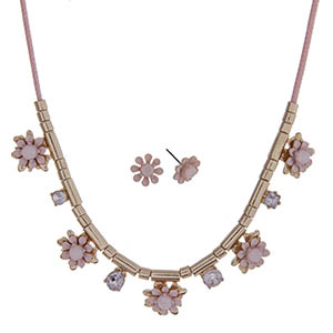 "Pink cord necklace set with light pink flowers and gold tone beads. Approximately 24"" in length."
