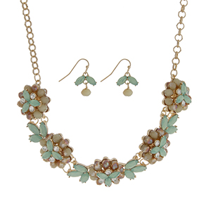 """Gold tone necklace set featuring five mint green glass stone flowers accented by clear rhinestones. Approximately 18"""" in length."""