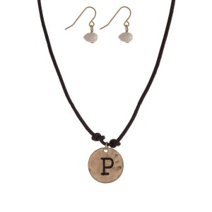 "Brown cord necklace with a gold tone pendant stamped with the letter ""P"" and a pearl closure. Approximately 18"" in length."