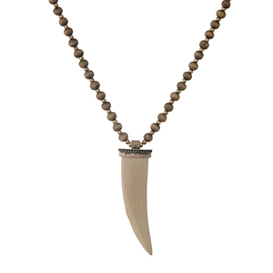 """Brown wooden beaded necklace with a tan horn pendant. Approximately 32"""" in length."""