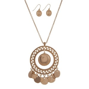 "Burnished gold tone necklace set with a Moroccan pendant. Approximately 32"" in length."