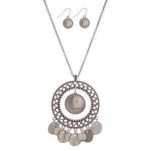 "Burnished silver tone necklace set with a Moroccan pendant. Approximately 32"" in length."