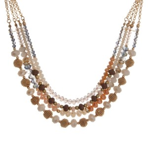 "Gold tone triple layer necklace with gray and ivory beads. Approximately 16"" in length."