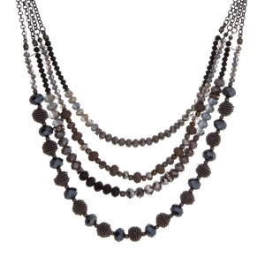 "Hematite tone triple layer necklace with gray and black beads. Approximately 16"" in length."