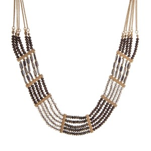 "Gold tone statement necklace with bronze, gray, and Dalmatian beads. Approximately 18"" in length."