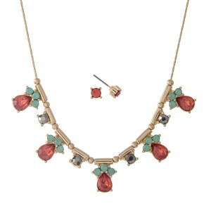 """Dainty gold tone necklace set with peach rhinestones. Approximately 16"""" in length."""