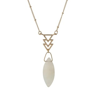 "Dainty gold tone necklace with arrows and an ivory oval stone. Approximately 16"" in length."