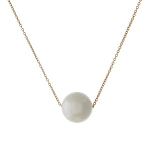 """Dainty gold tone necklace with a 14mm cream pearl bead. Approximately 16"""" in length."""