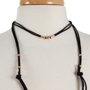 """Black suede wrap necklace with gold tone hardware. Approximately 32"""" in length."""