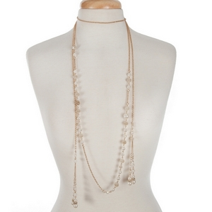 """Gold tone double layer pearl and ivory beaded necklace set with a lariat layer and matching earrings. Approximately 32"""" in length."""