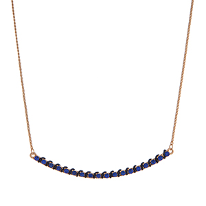 """Dainty gold tone necklace with a blue rhinestone bar wrapped with navy fabric. Approximately 16"""" in length."""