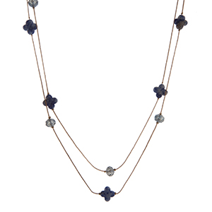 """Dainty gold tone wrap necklace with navy beads and quatrefoil stones. Approximately 60"""" in length."""