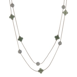 """Dainty gold tone wrap necklace with jade beads and quatrefoil stones. Approximately 60"""" in length."""