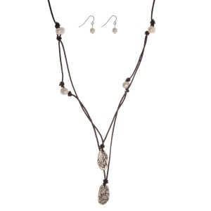 """Black double layer cord necklace with freshwater pearl beads and silver tone charms. Approximately 18"""" in length."""