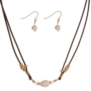 """Brown cord necklace set with a freshwater pearl bead and matching fishhook earrings. Approximately 16"""" in length."""