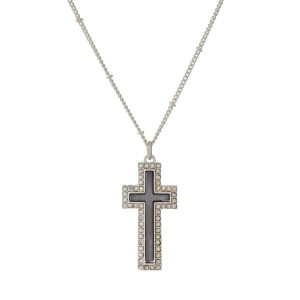 """Silver tone necklace with a cross pendant surrounded by iridescent rhinestones. Approximately 26"""" in length."""