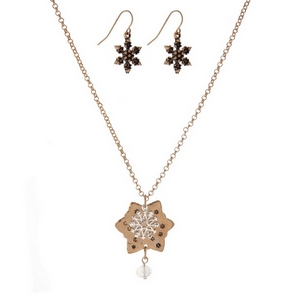 """Gold tone, dainty necklace set with a two tone snowflake pendant and matching fishhook earrings. Approximately 16"""" in length."""