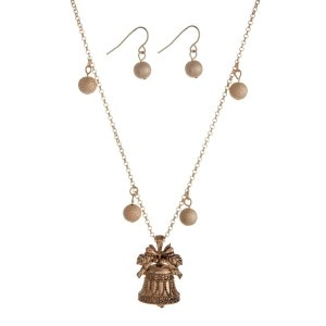 """Gold tone necklace set with a Christmas bell pendant and matching fishhook earrings. Approximately 18"""" in length."""