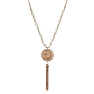 "Gold tone necklace with freshwater pearl beads, a 'D' initial, and a chain tassel. Approximately 27"" in length."