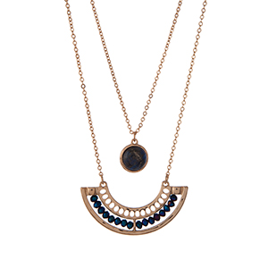 """Gold tone double layer necklace with navy blue beads and a lapis stone. Approximately 30"""" in length."""