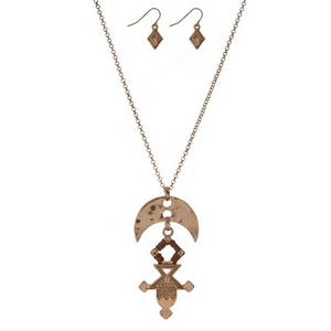 """Gold tone necklace set with an Aztec pendant and matching fishhook earrings. Approximately 32"""" in length."""