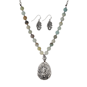 "Silver tone necklace set with amazonite beads, a mermaid pendant, and matching fishhook earrings. Approximately 18"" in length."