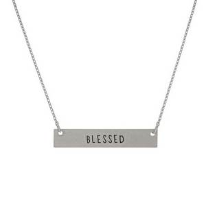 "Dainty silver tone necklace with a bar focal, stamped with ""Blessed."" Approximately 16"" in length."