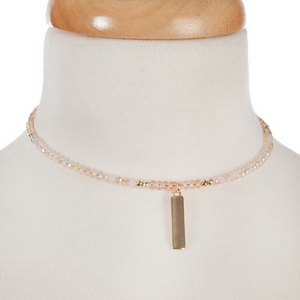 "Pink and gold tone beaded coil choker with a bar pendant. Approximately 12"" around."