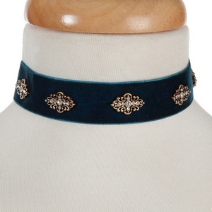 "Blue velvet choker with gold tone accents. Approximately 12"" in length."