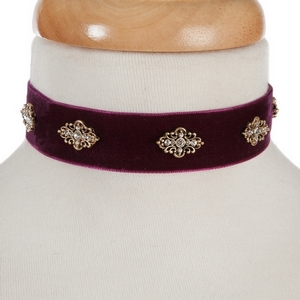 "Burgundy velvet choker with gold tone accents. Approximately 12"" in length."