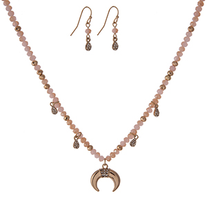 "Dainty gold tone necklace set with light pink faceted beads and a crescent pendant and matching fishhook earrings. Approximately 16"" in length."