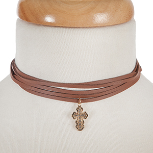 """Brown, faux leather wrap necklace with a gold tone cross pendant, accented by clear rhinestones. Approximately 74"""" in length."""