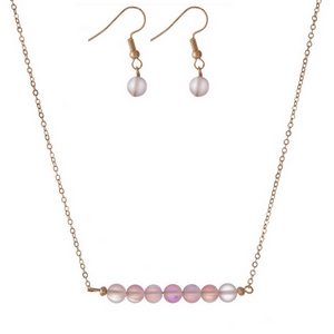 "Gold tone necklace set with light pink iridescent beads and matching fishhook earrings. Approximately 16"" in length."