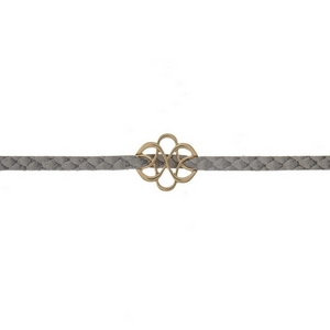 "Gray faux suede choker with a gold tone swirl focal. Approximately 12"" in length."