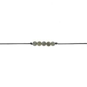 "Black waxed cord choker with gray colored beads. Approximately 12"" in length."