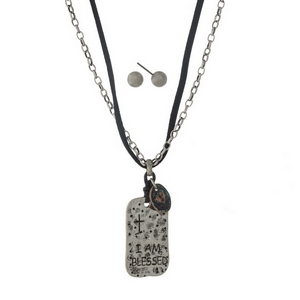 "Black faux suede and silver tone necklace set with a hammered pendant, stamped with ""I am Blessed."" Approximately 18"" in length."