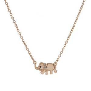 """Dainty gold tone necklace with an elephant pendant, accented with clear rhinestones. Approximately 16"""" in length."""
