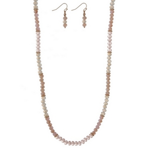 "Gold tone necklace set with opal, ivory, and pink faceted beads and matching fishhook earrings. Approximately 30"" in length."