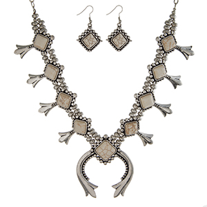 "Silver tone statement necklace set with ivory stones and squash blossoms. Approximately 18"" in length."