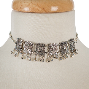 "Silver tone metal choker with matching stud earrings. Approximately 12"" in length."